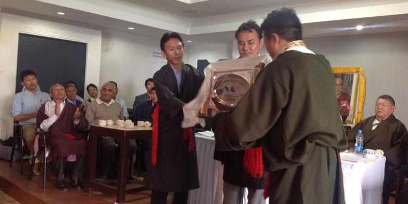 Presenting Yuthog Award to Ven. Troru Tsenam Rinpoche